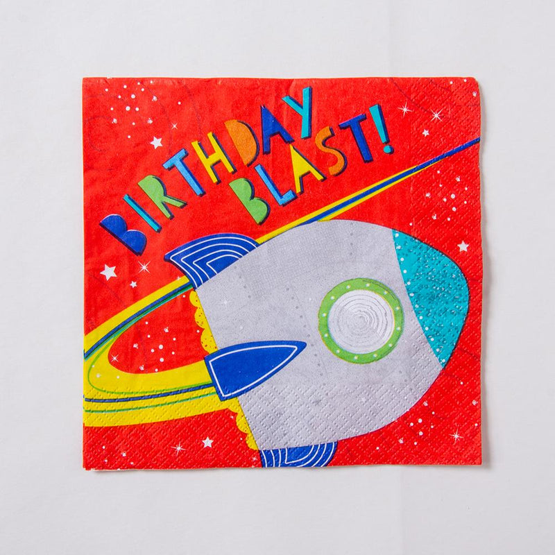 A bright red birthday party napkin with a space rocket design