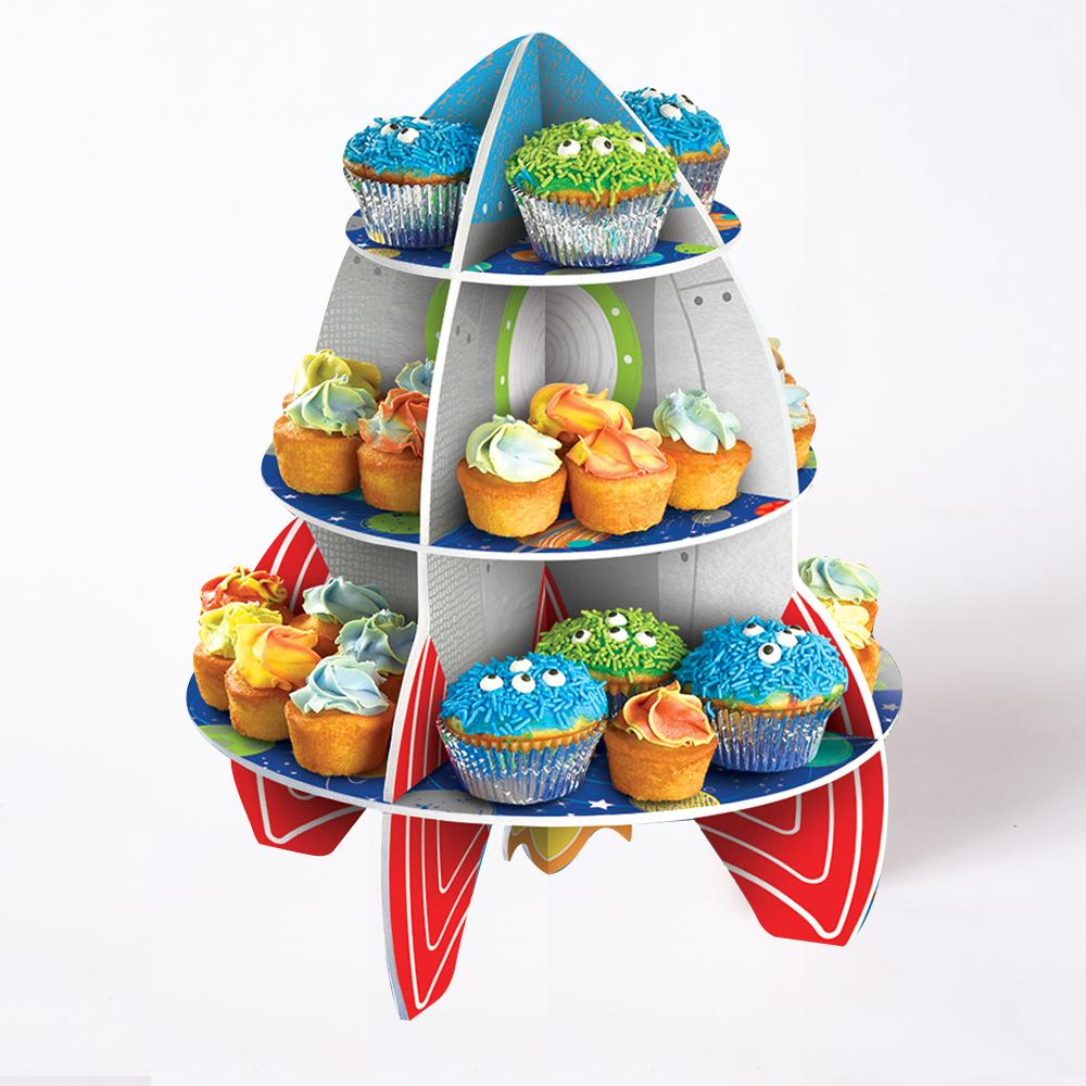 A rocket-shaped cake stand filled with cupcakes