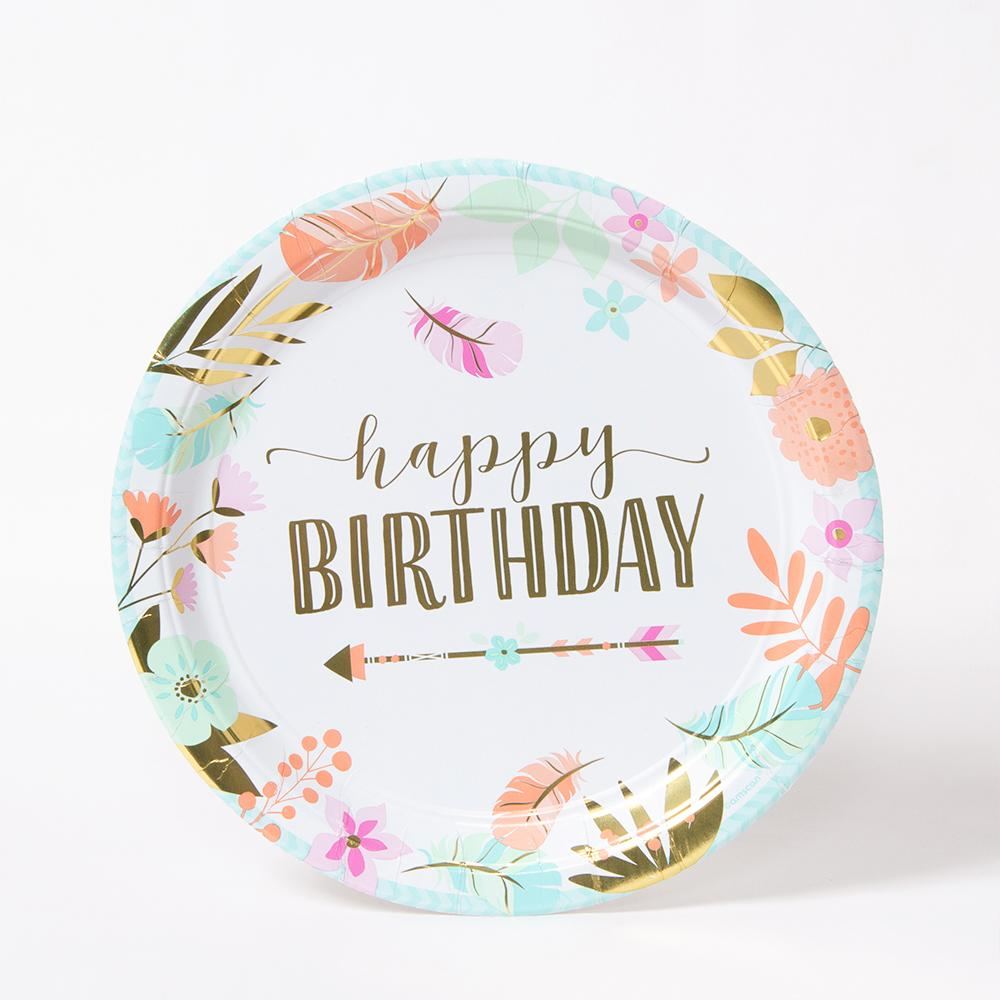 A party plate with gold foil happy birthday message and flowery design
