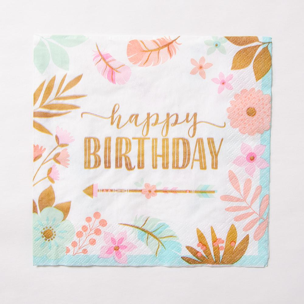 A single napkin with a floral design and gold foil Happy Birthday phrase