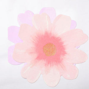 A flower-shaped napkin with pink petals and gold sparkly centre