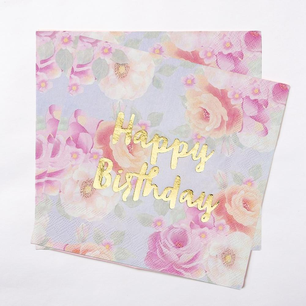 "2 party napkins with a pastel flower design and gold foil ""Happy Birthday"" greeting"