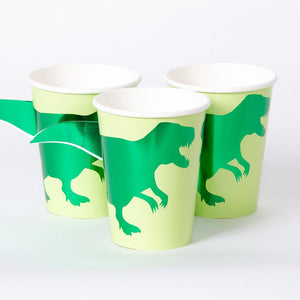 A set of light green party cups with shiny green foil T-Rex shapes