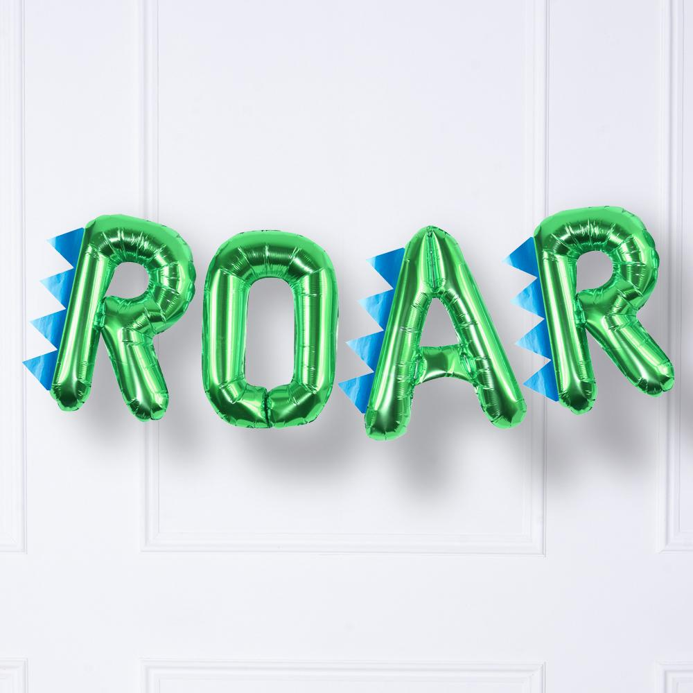 "A shiny green foil dinosaur balloon bunting saying ""ROAR"""