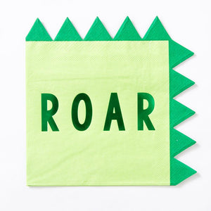 "A party napkin with a dinosaur-styled spine and a big green foil ""ROAR"" phrase"
