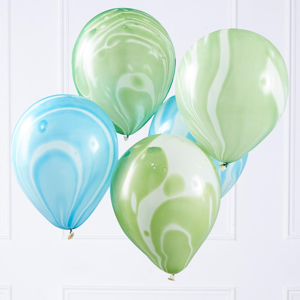 A bunch of green and blue marbled latex party balloons