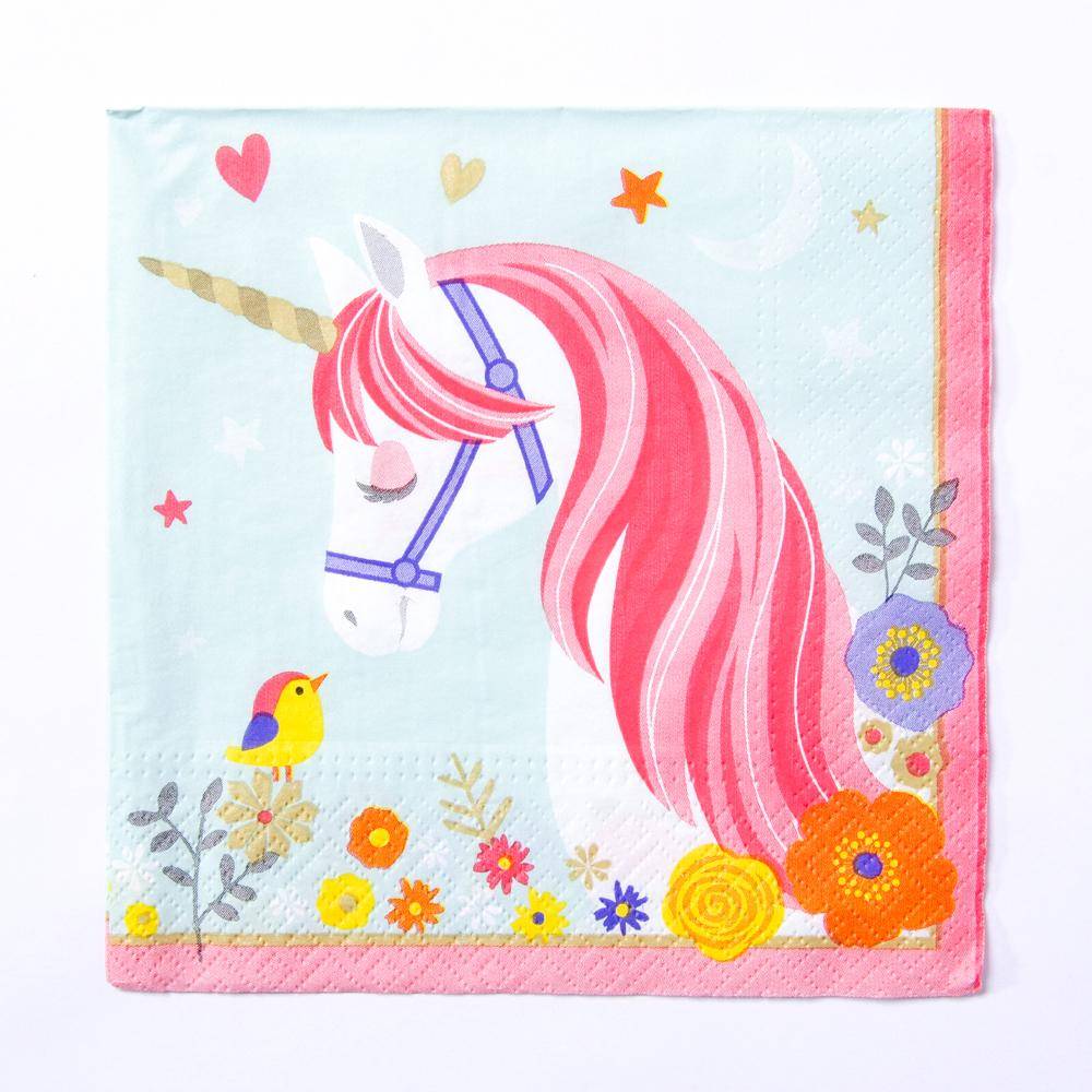A Unicorn-themed party napkin with colourful flowers and a unicorn