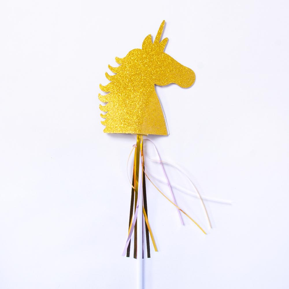 A glittery gold unicorn-themed party wand