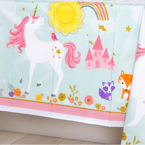 A unicorn-themed table cover featuring a rainbow, castle, and unicorn design