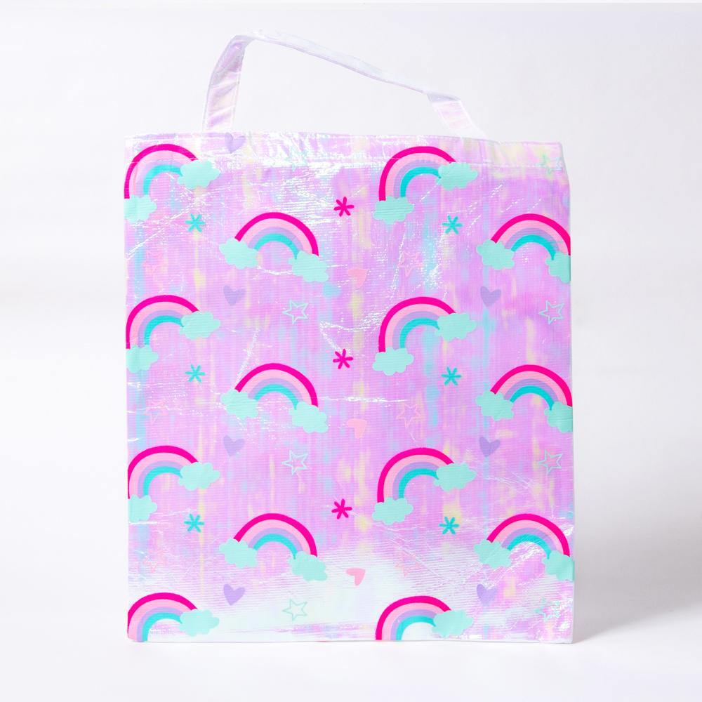 A rainbow-covered iridescent unicorn party gift bag