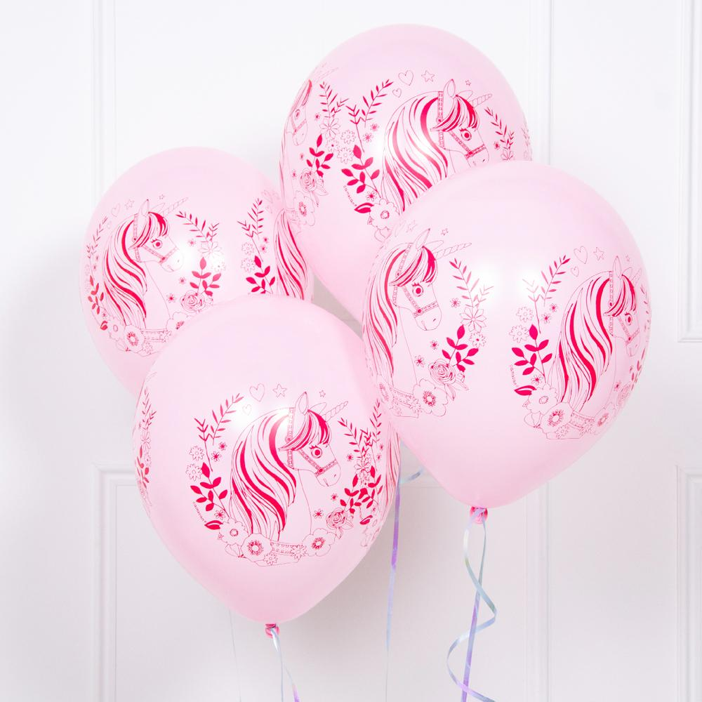 4 pink latex party balloons featuring pink and white unicorns