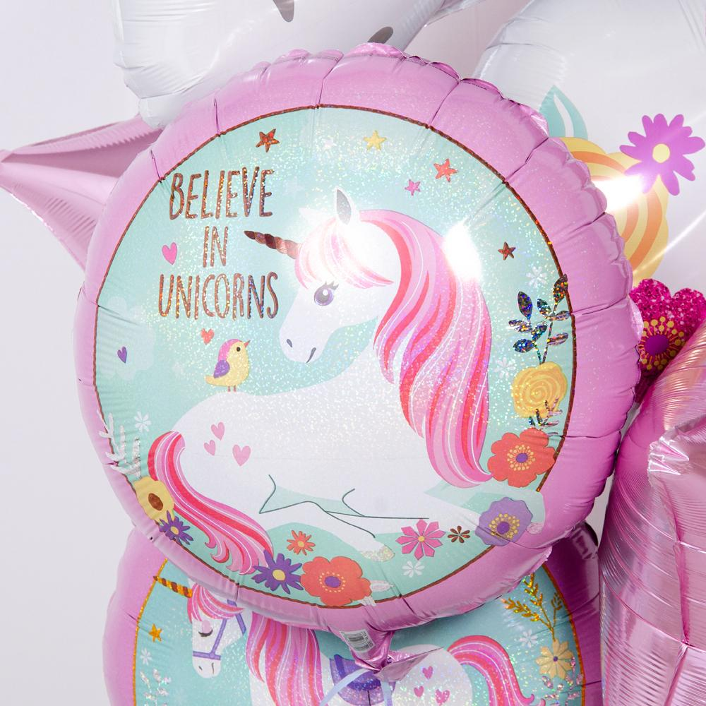 "A round, unicorn-themed helium party balloon with ""Believe in Unicorns"" message"