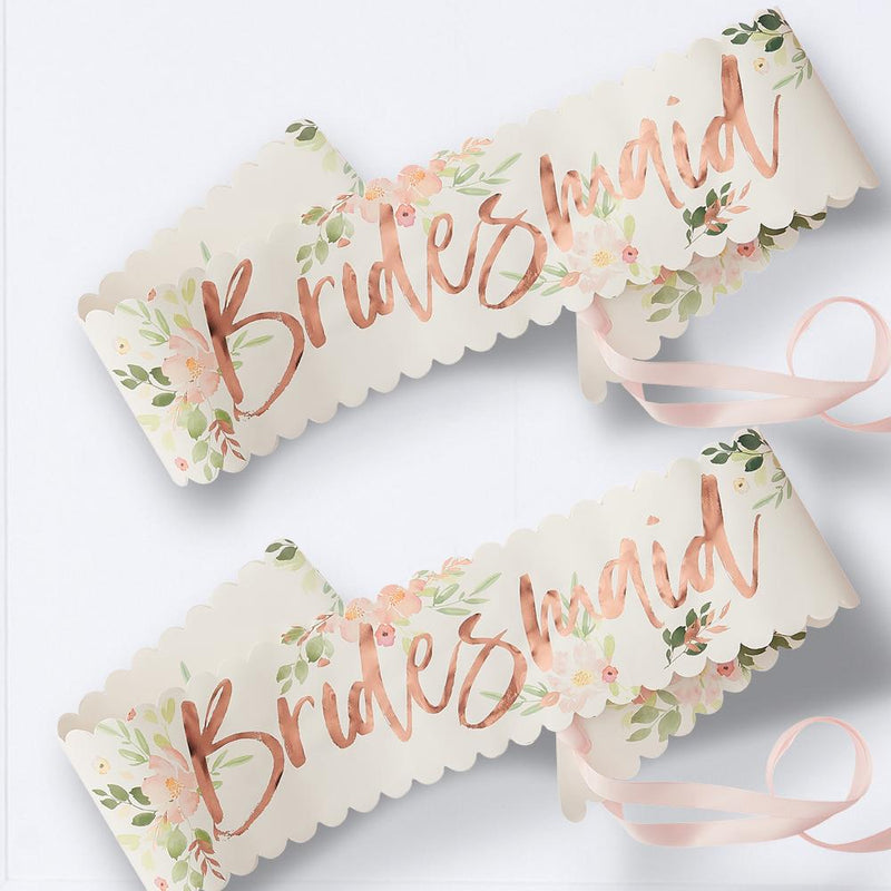 2 bridesmaid party sashes with floral design and rose gold foil