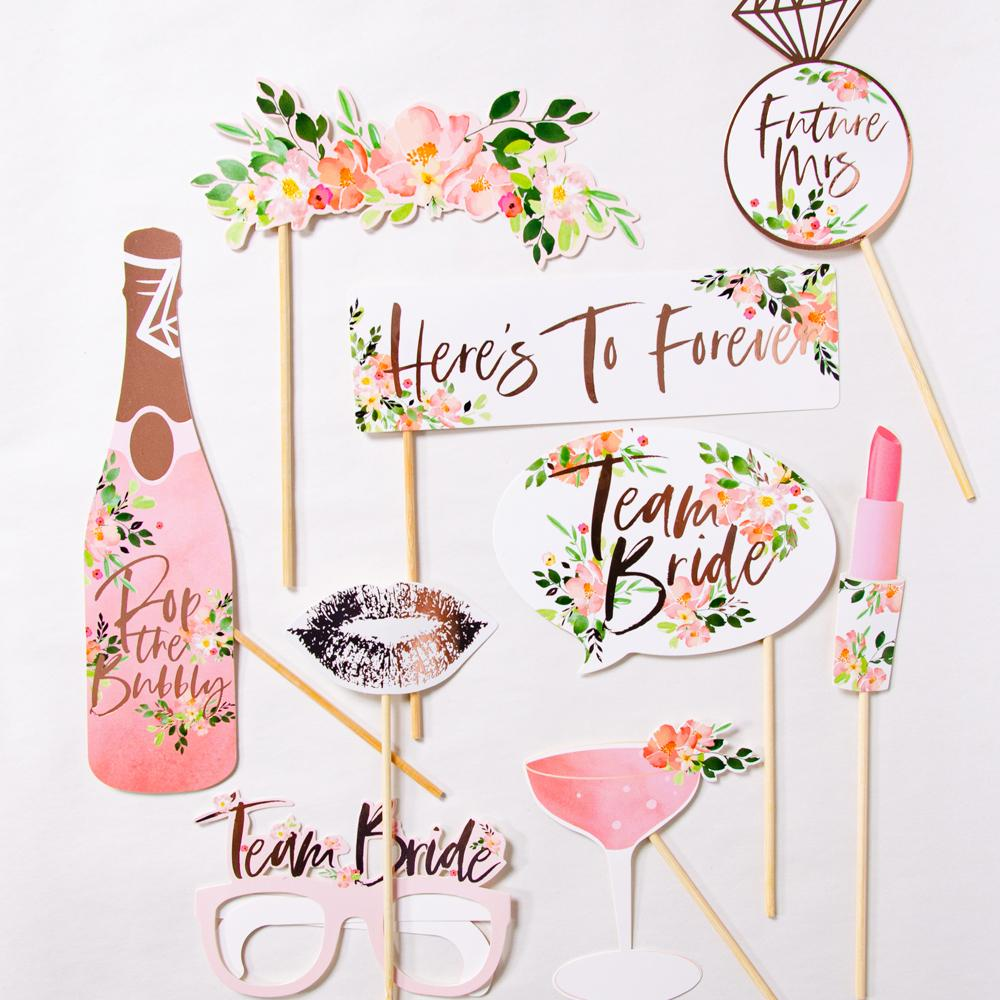 Collection of hen party photobooth props laid out on a white background