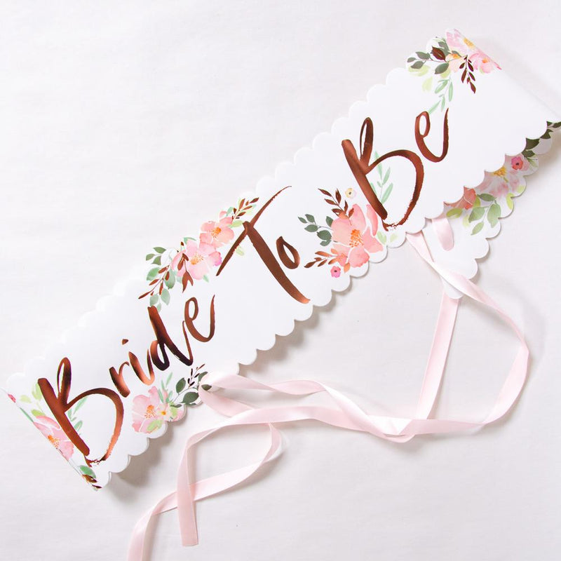 Bride To Be hen party sash laid out on a table