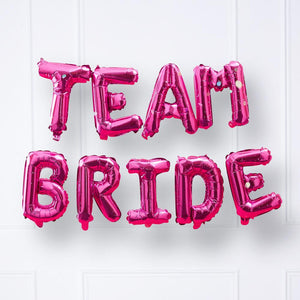 "Shiny pink foil balloon phrase saying ""Team Bride"""