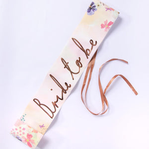 "Hen do Sash saying ""Bride to Be"" in rose gold text"
