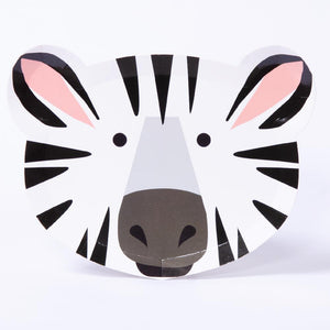 A paper party plate in the shape and style of a happy zebra