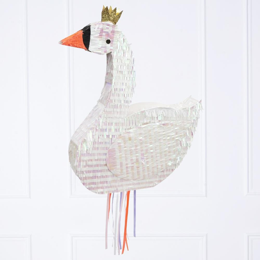 A swan-shaped party pinata wearing a gold crown and with multicoloured tissue tassels