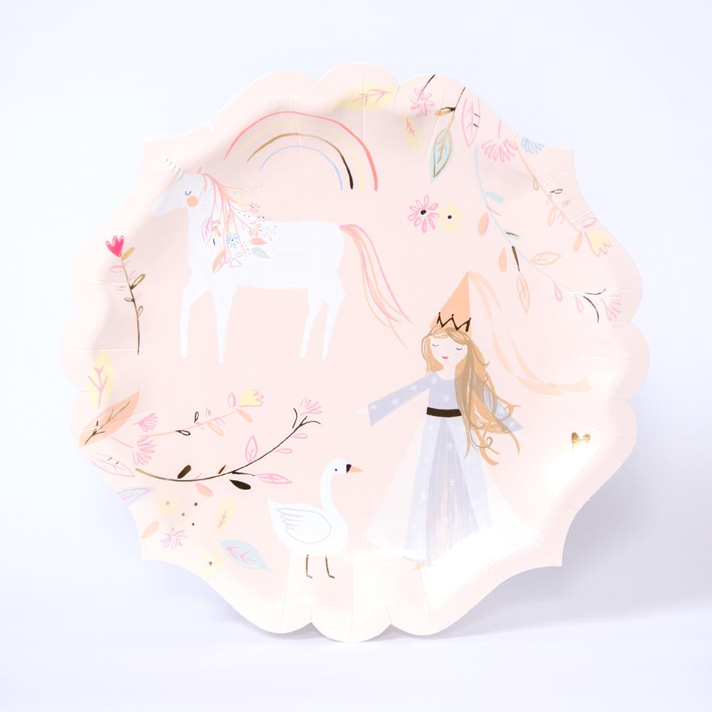 A pink party plate featuring princesses, unicorns, and swans