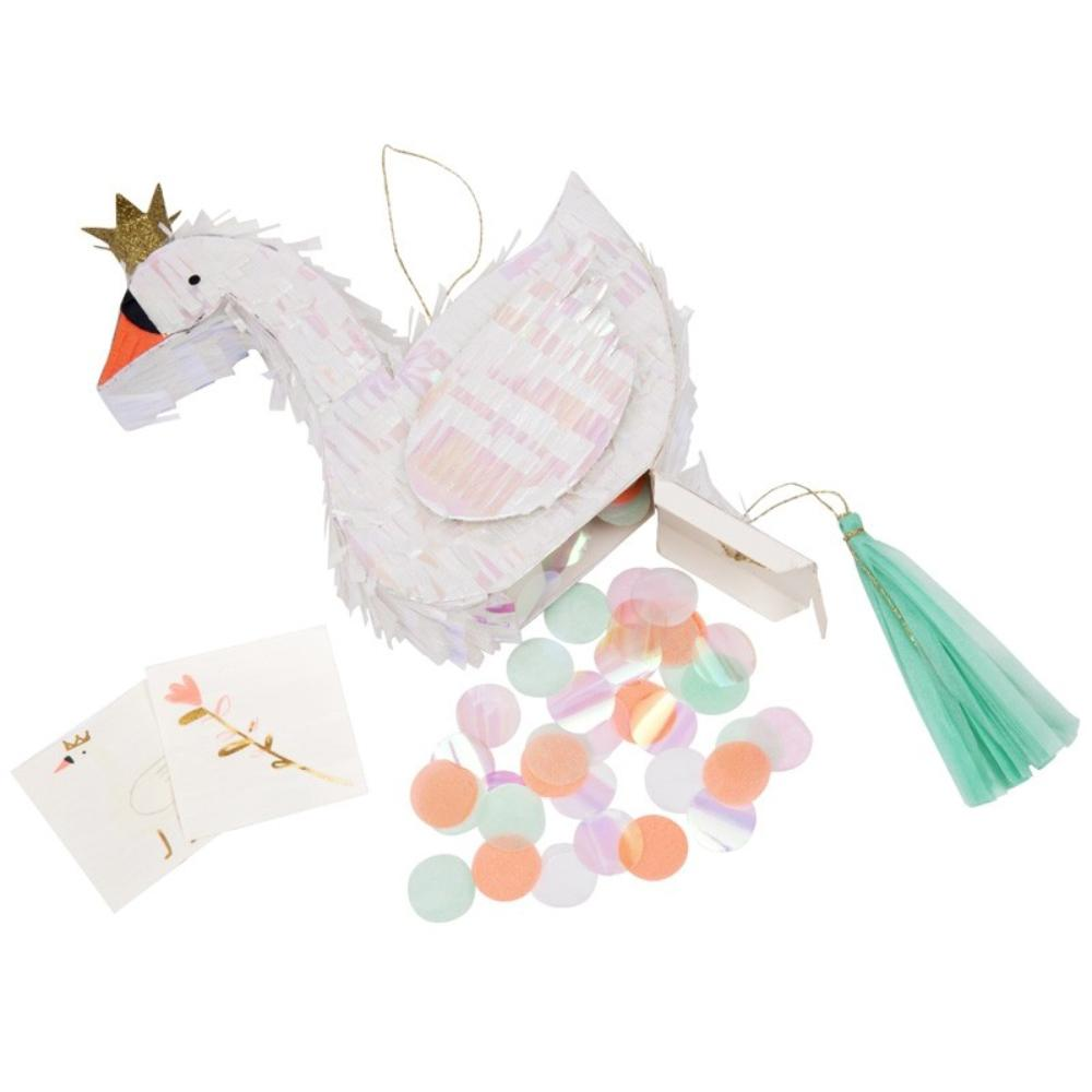 A miniature paper swan pinata wearing a glitter gold crown