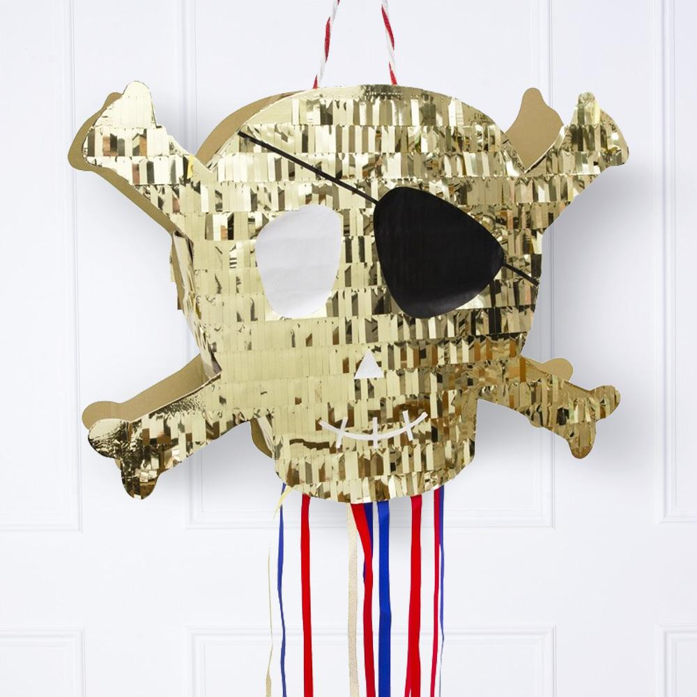 A glimmery gold, skull and crossbone-shaped pinata for a pirate party