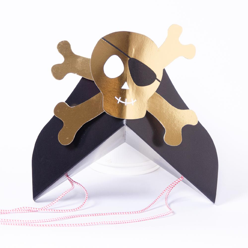 A pirate captain cap-style party hat with a glimmery gold foil skull and crossbones design