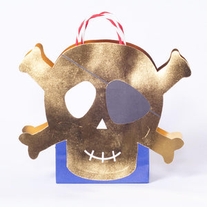 A pirate-themed party bag with a giant shiny gold skull and crossbones design