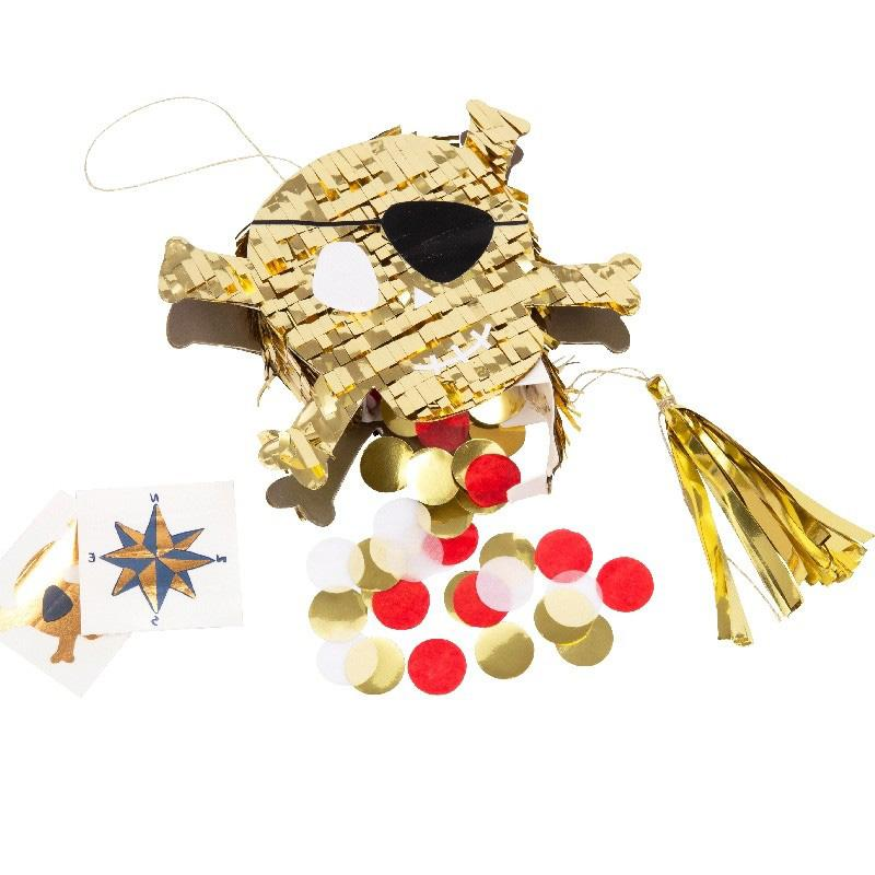 A mini skull and crossbones-shaped pinata with gold confetti and pirate cards