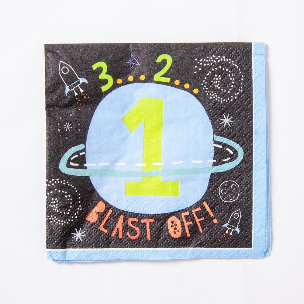 A space-themed napkin with a planet design and countdown phrase