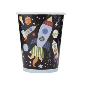 A paper party cups covered in illustrations of planets, comets, and spacecraft