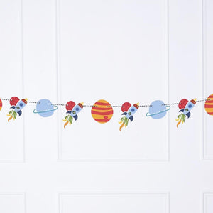 A space-themed party banner with planets and rocket shapes