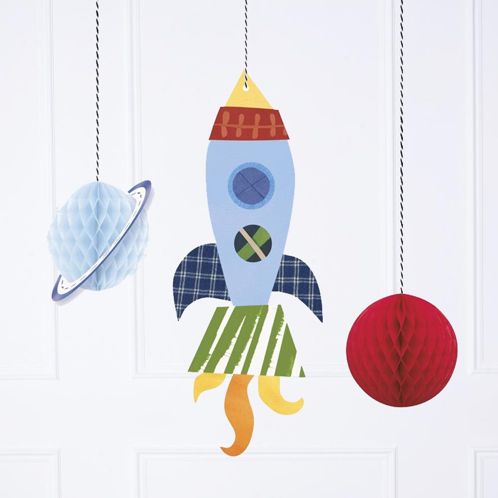 A set of space-themed party decorations hanging from the ceiling