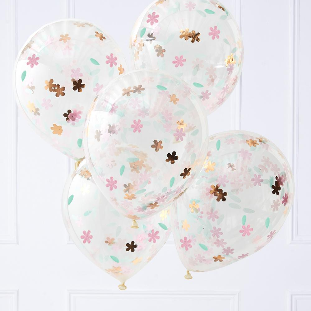 A bunch of clear confetti-filled balloons filled with foil flower shapes