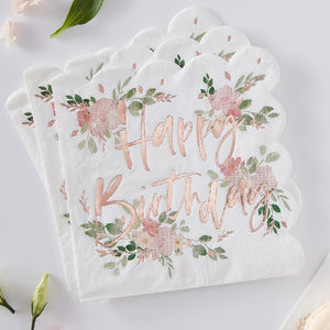 A set of scallop-edged party napkins with a Happy Birthday greeting and floral design