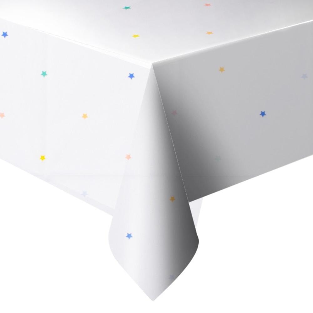 A white party table cover speckled with rainbow-coloured stars
