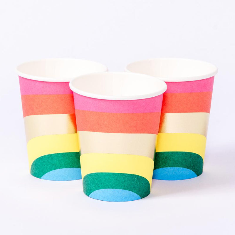3 party cups with a striped rainbow design