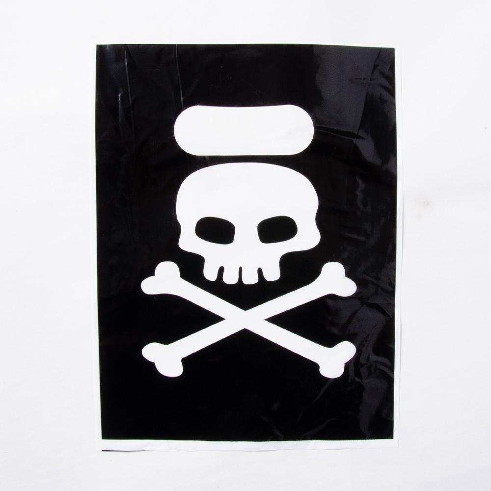 A pirate-themed party bag with a black and white, skull and crossbones design