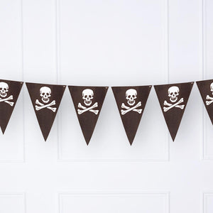 A pirate-themed party bunting with black pennants and skull and crossbone prints