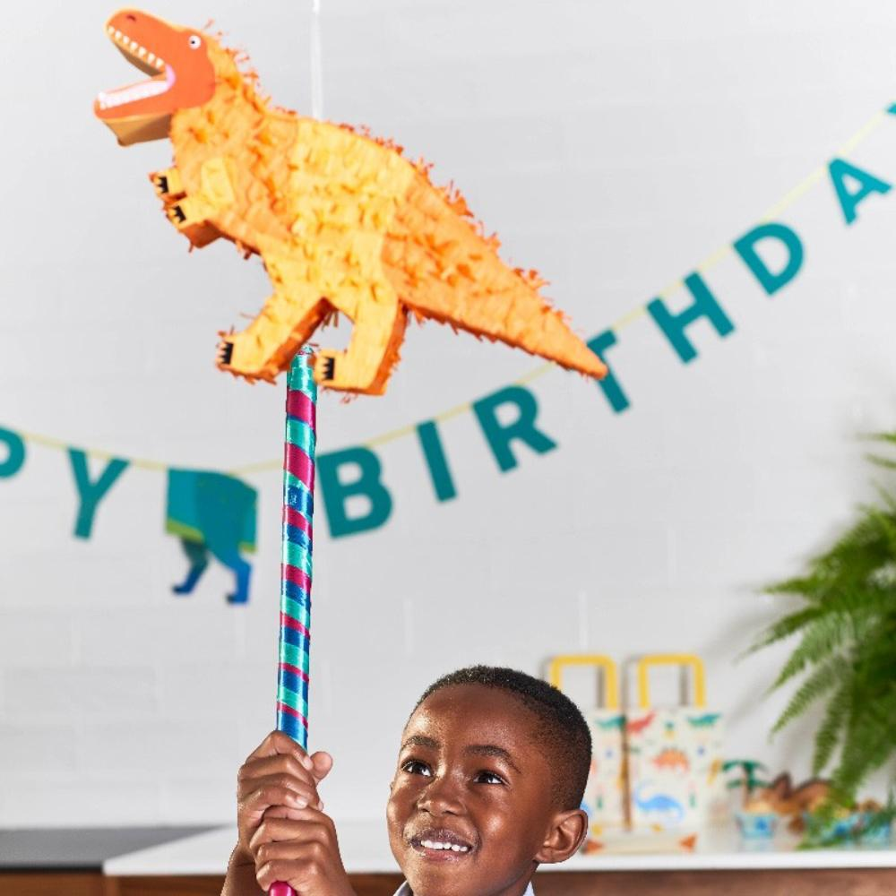 A miniature orange T-Rex-shaped dinosaur pinata