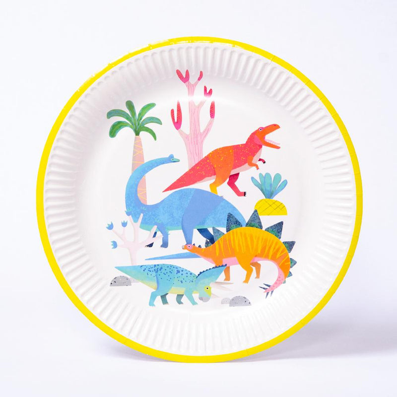 A round, white and yellow party plate featuring a colourful dinosaur design