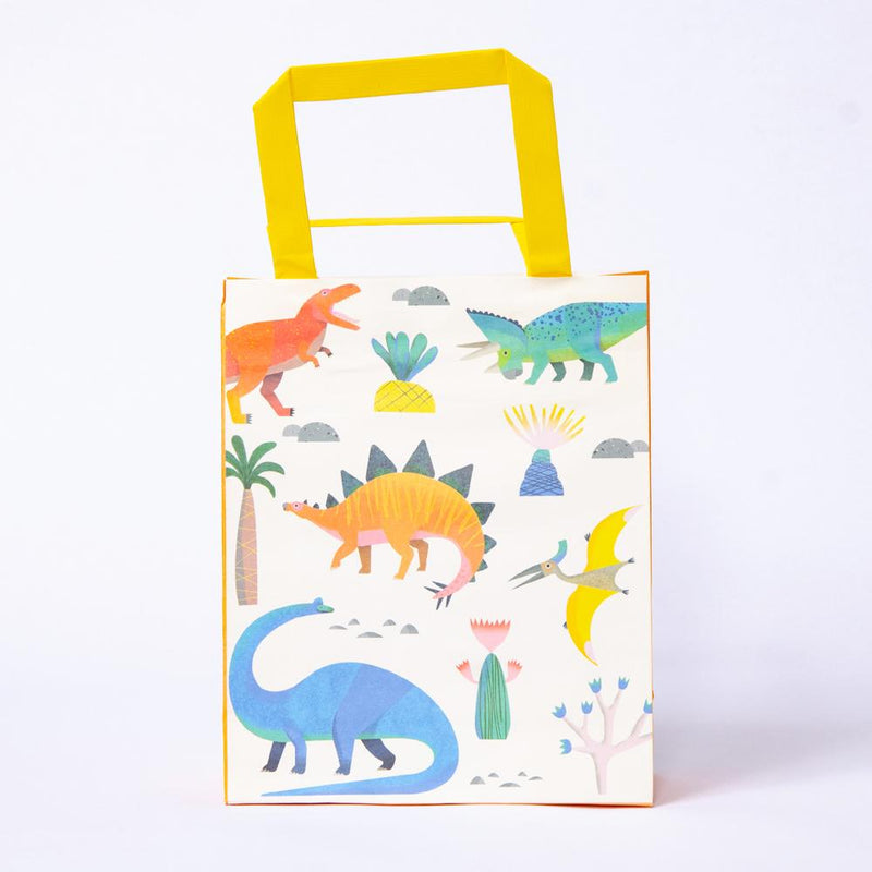 A dinosaur-themed party bag with a variety of cute pastel dinosaurs and a yellow handle