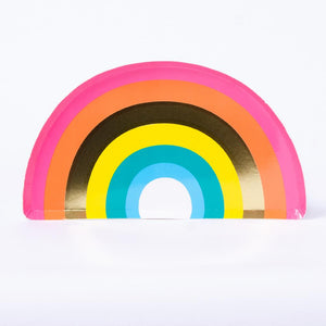 An arch-shaped party plate with a colourful rainbow-striped design