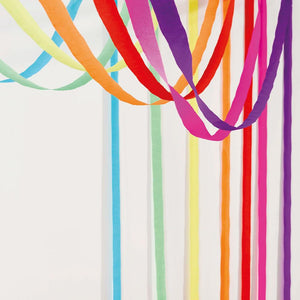 Multicoloured paper party streamers hanging across a ceiling