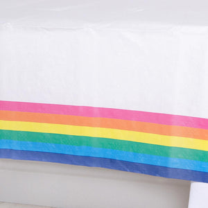 A table cover with a colourful rainbow design on the edges