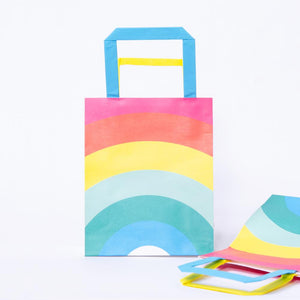 2 paper party bags with pastel Rainbow designs