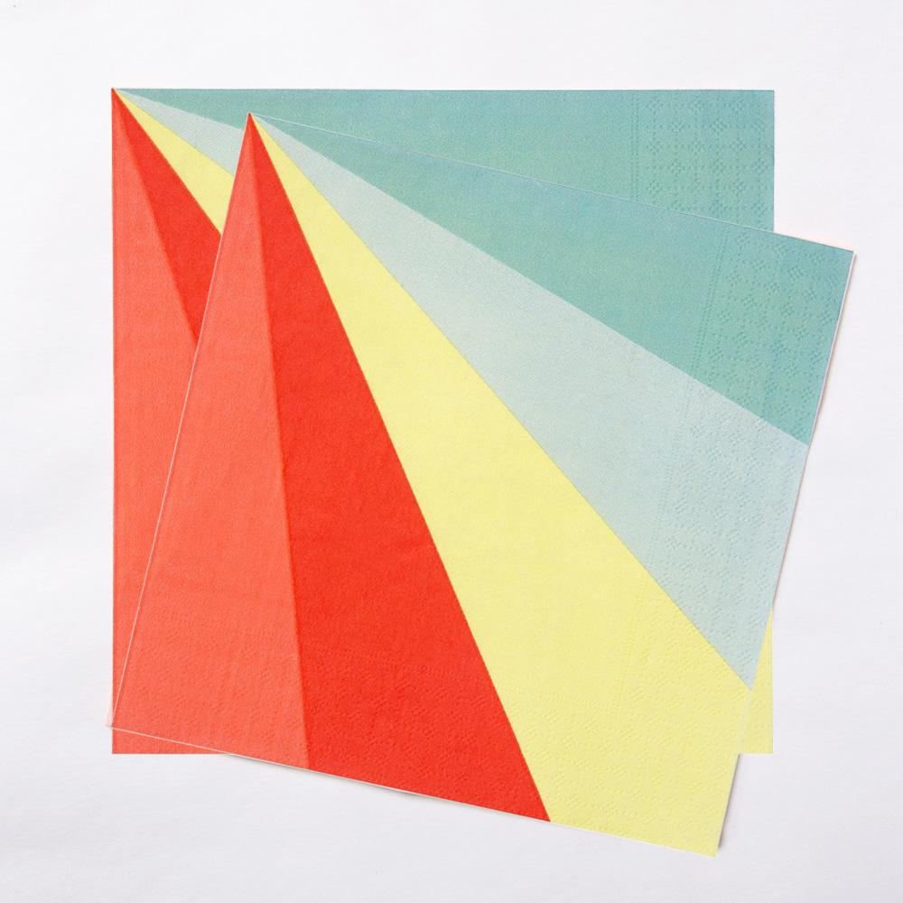 A pair of rainbow-themed party napkins with a diagonal line design