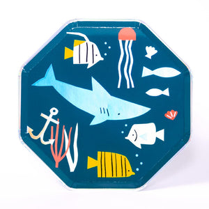 A octagonal ocean-themed party plate featuring a blue iridescent foil finish and fish shapes
