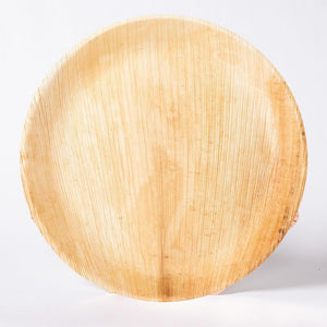 A round wooden party plate made from bamboo