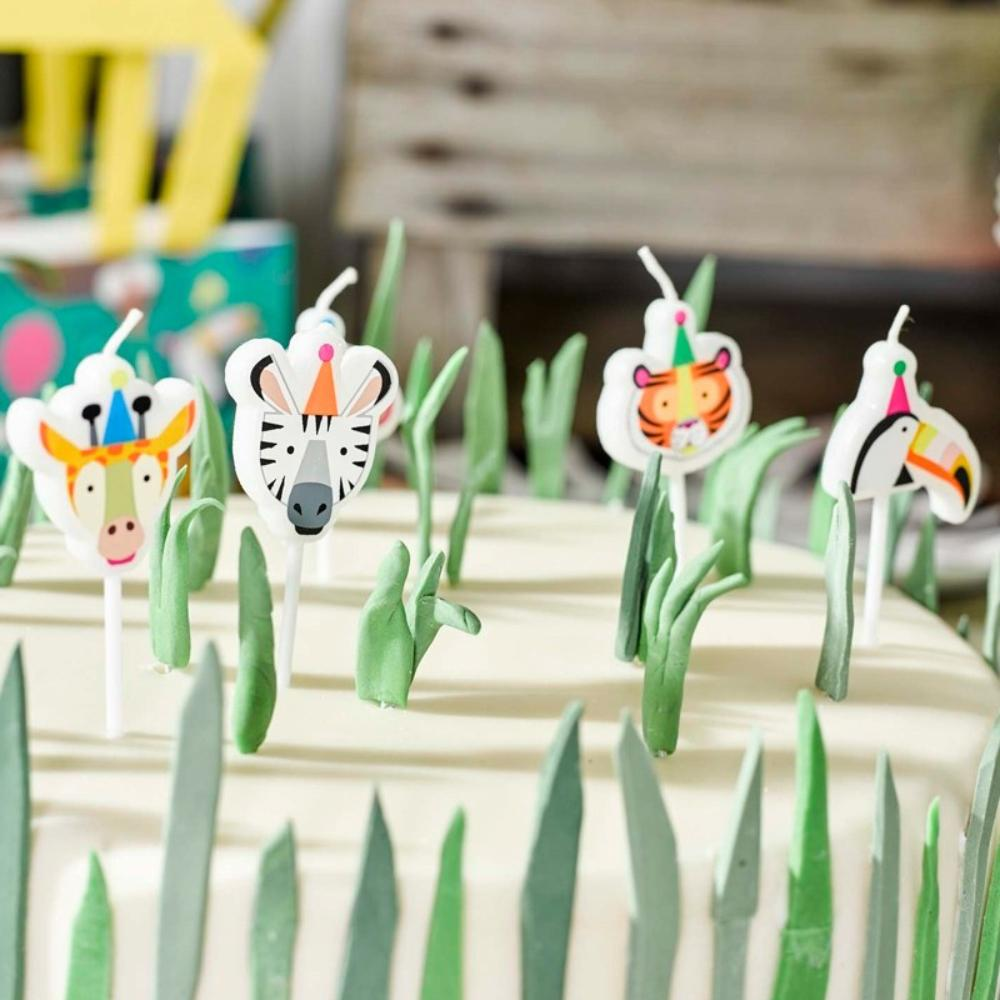 A set of 4 cake candles with a jungle animals theme